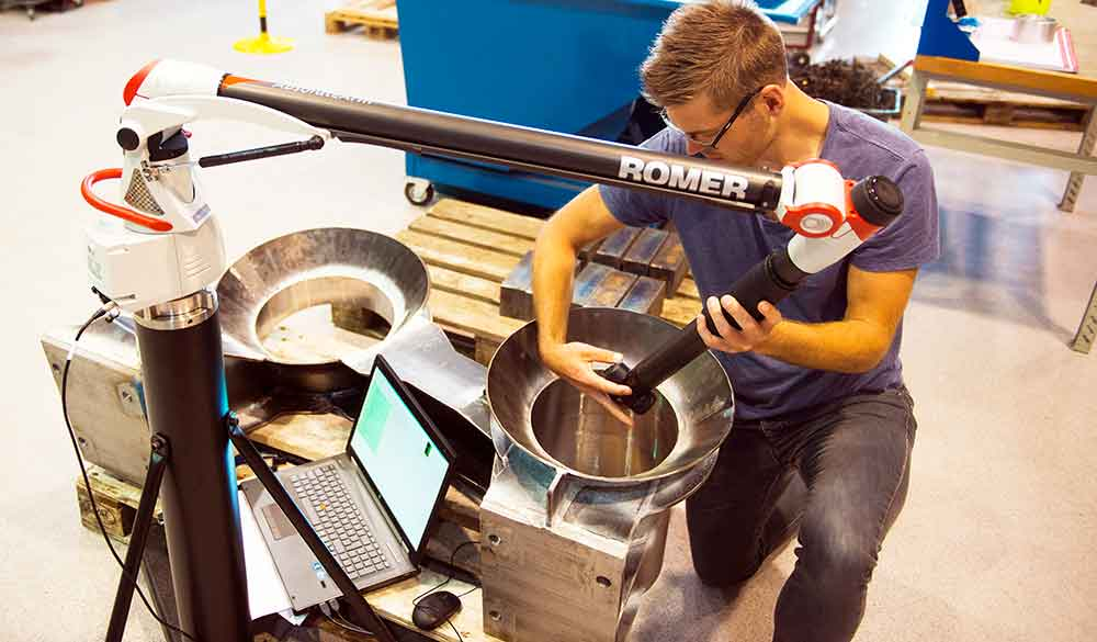 A male employee at Depro who works with control measuring subsea equipment using Romer control measuring arm.