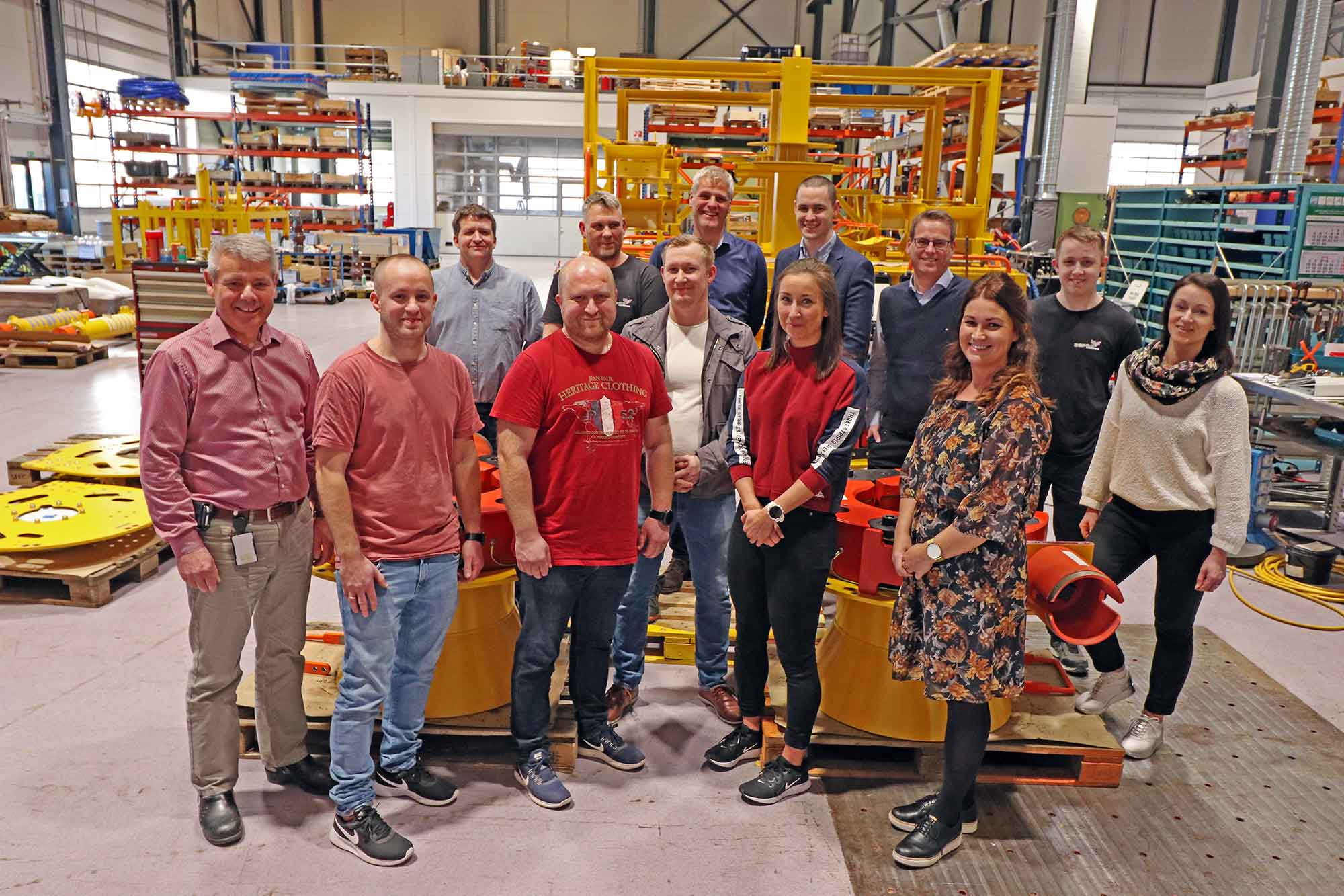 Twelve new employees at Depro March 2019 standing in the workshop.