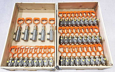 A lot of ROV Hot-Stabs and Receptacles in a wood box.